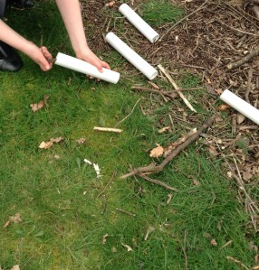 The children filled tubes with sticks and dead leaves.
